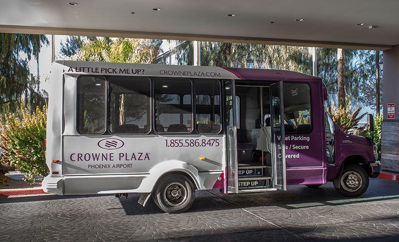 Photo of the Crowne Plaza Phoenix Airport Hotel shuttle idle with open doors